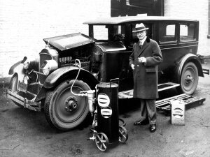 Adding motor oil (L. D. Taylor) to automobile (ca193-) - Vancouver BC